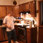Bill cooking dinner for Krystal and friend