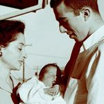 Joel Spivak holding his newborn daughter Amanda in Houston, 1958, with his mother Fritzi